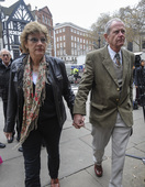Sarah Hermitage and her husband appear at The Royal Courts of Justice in London.