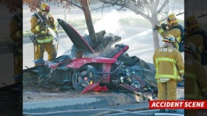 "First responders gather evidence near the wreckage of a Porsche sports car that crashed into a light pole on Hercules Street near Kelly Johnson Parkway in Valencia on Saturday, Nov. 30, 2013. A publicist for actor Paul Walker says the star of the ""Fast & Furious"" movie series has died in a car crash north of Los Angeles. He was 40. Ame Van Iden says Walker died Saturday afternoon. No further details were released. (AP Photo/The Santa Clarita Valley Signal, Dan Watson)"